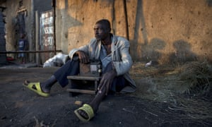 A man listens to the news on the radio in Bujumbura.