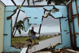Greville Blank scours for possessions around his destroyed home following the devastating Cyclone Yasi in Tully Heads, north Queensland, in February 2011.