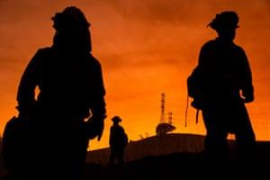 Firefighting crews battle the Kincade fire in Healdsburg, California.