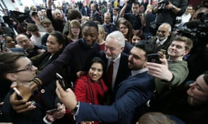 Labour leader Jeremy Corbyn poses for selfies with supporters after he delivered a Brexit speech