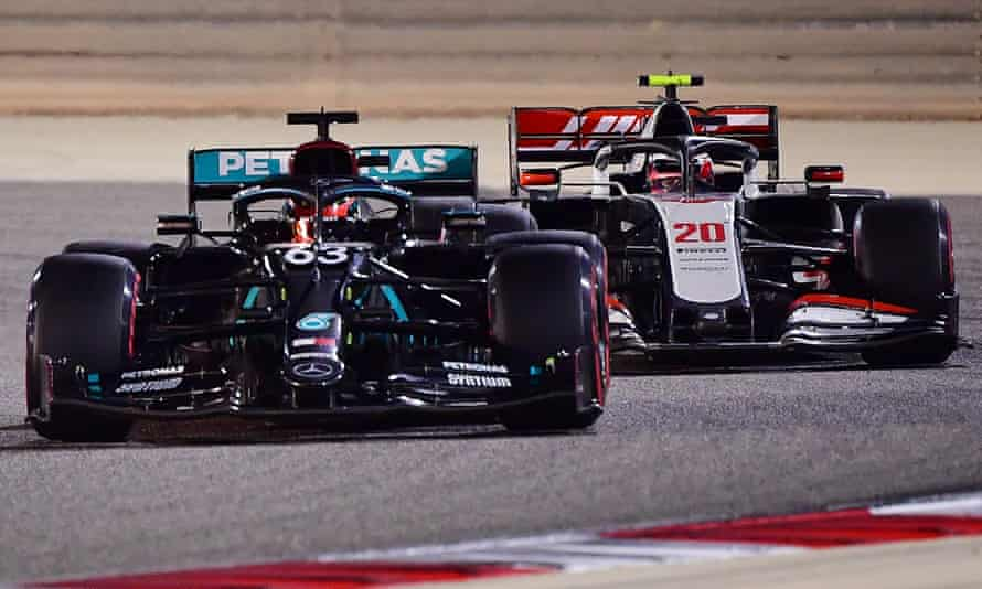 Mercedes' George Russell, No 63, battles with the Haas of Kevin Magnussen during the Sakhir Grand Prix.
