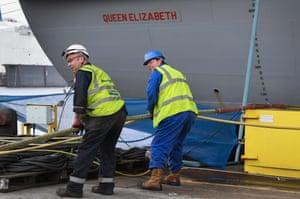 Contract workers busy beside HMS Queen Elizabeth