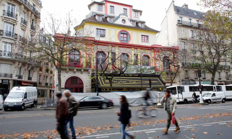 Pedestrians walk past a police fence which cordons off the entrance of the Bataclan music venue in Paris.