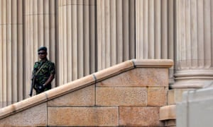 A Sri Lankan special taskforce soldier stands guard outside the presidential secretariat in Colombo