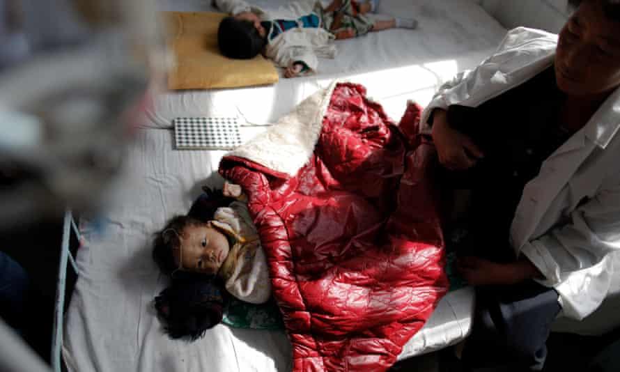 North Korean children suffering from malnutrition rest in a hospital in Haeju.