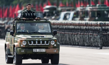 President Xi Jinping inspects People's Liberation Army soldiers at a barracks in Hong Kong on Friday.