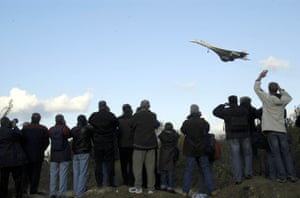 British fans watch the last British Airways Concorde approach Heathrow