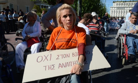 Disabled people protest against cuts to their pensions and benefits outside the Greek parliament earlier this month.