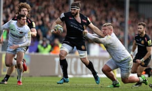 Exeter's Don Armand is held by Richard Barrington of Saracens during their Premiership match.