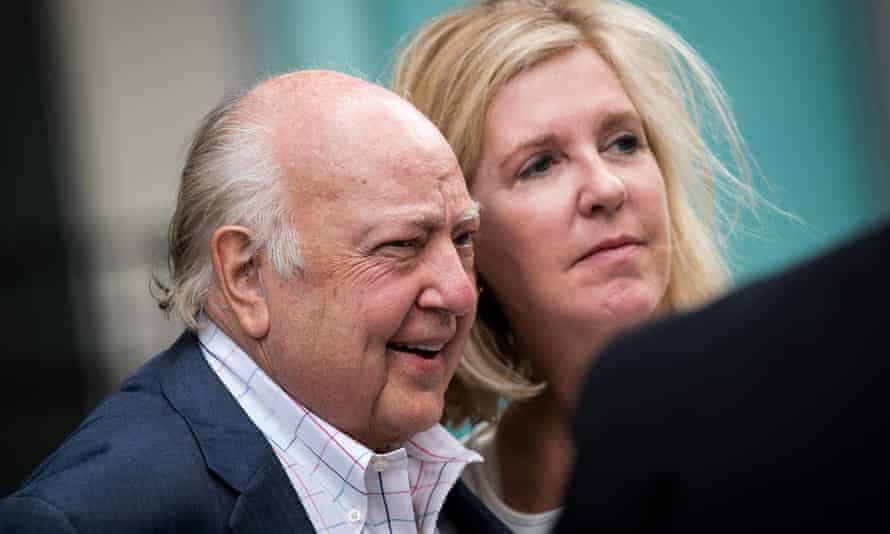 Roger Ailes walks with his wife Elizabeth Tilson as they leave the News Corp building in New York City on Tuesday.
