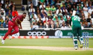 West Indies' Oshane Thomas bowls a LBW to dismiss Pakistan's Shadab Khan.