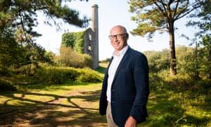 Jeremy Wrathall standing next to historical Cornish mine