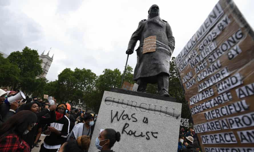 Protesters gather in Parliament Square Garden, London, on Sunday.