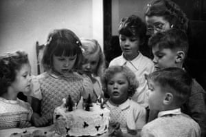 Christmas Cake, December 1951. There's plenty to eat at a children's party, despite rationing