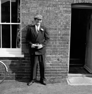 A man stands outside the Engineer pub, 1966