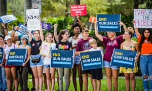 Members of March For Our Lives are joined by members of the community to protest Walmart gun sales in Coral Springs, Florida.