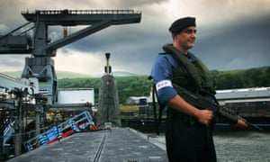 Guard aboard HMS Vengeance, a Trident missile nuclear submarine, at Faslane naval base on the Clyde