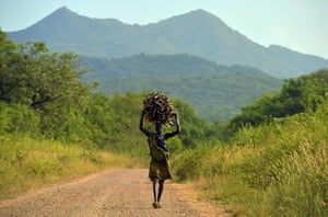 A woman from the Suri tribe carries firewood