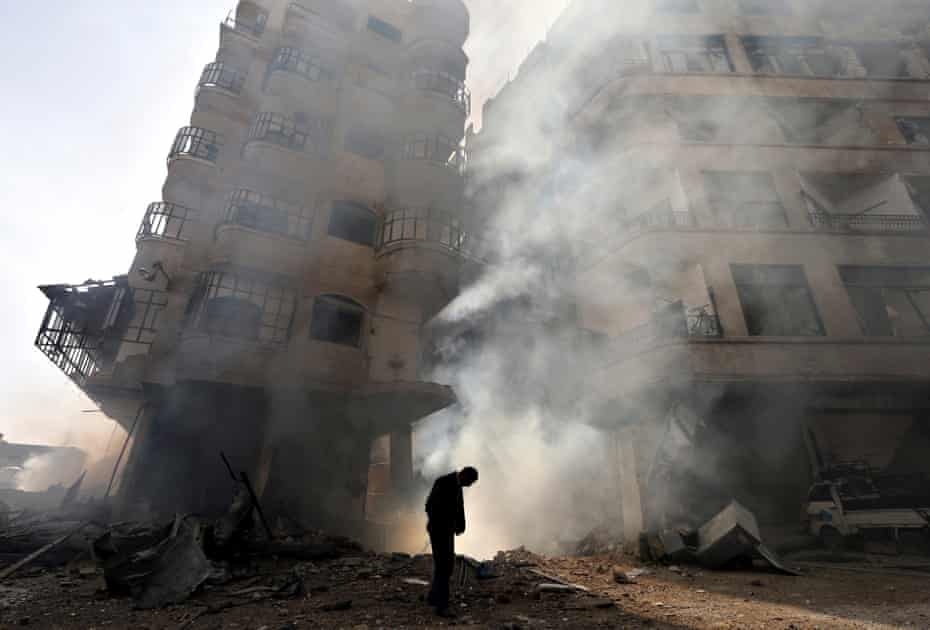 The aftermath of a Syrian Air Force strike on the Ain Tarma neighbourhood of Damascus.