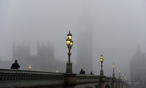 Fog obscures the houses of parliament in central London