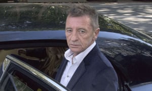 Former AC/DC drummer Phil Rudd (C) leaves the District Court after being sentenced to 8 months home detention in Tauranga, New Zealand on July 9, 2015.