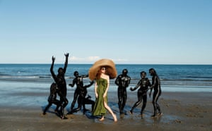 Venice, ItalyLotte Verbeek poses with performers at the beach promoting the film the Book of Vision at the Venice Film Festival