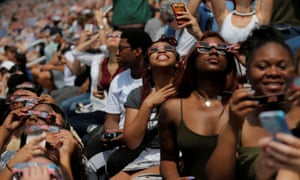 Guests watch the final moments before the total eclipse at the football stadium at Southern Illinois University in Carbondale, Illinois.