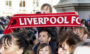 A young fan holds a Liverpool scarf during the Hillsborough vigil at St George's Hall on Wednesday.