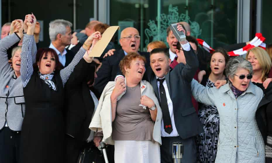 Relatives, survivors and supporters celebrate as they leave the inquests in Warrington.