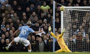 Manchester City's Sergio Aguero smacks the ball past Chelsea's goalkeeper Kepa Arrizabalaga and against the crossbar.