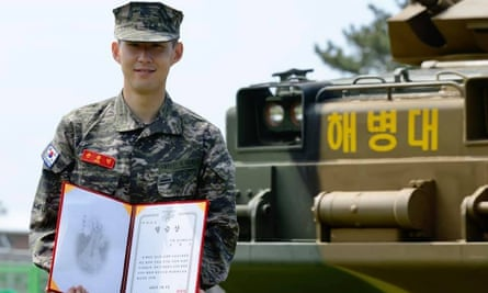 Son Heung-min smiles during a completion ceremony at a military camp in Jeju, South Korea.