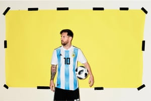 Lionel Messi poses with the Adidas Telstar 18 official World Cup match ball in front a yellow background, reassuringly held up with black gaffer tape.