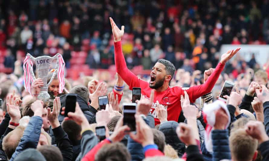 Leyton Orient's Jobi McAnuff is lifted up by fans after being promoted to the Football League.