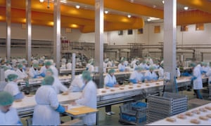 Workers make sandwiches at Greencore's factory in Northampton