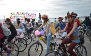 Turkish women ride their bikes during a parade to celebrate World Car-Free Day in Istanbul