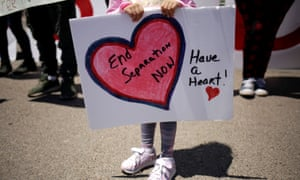 A child holds a placard during a protest against the treatment and conditions of children in immigration detention outside U.S. Customs and Border Protection's Border Patrol station facilities in Clint, Texas, U.S., June 27, 2019. REUTERS/Jose Luis Gonzalez Gonzalez