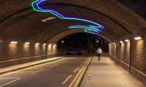Person walking alone down an underpass late at night,Vauxhall,London