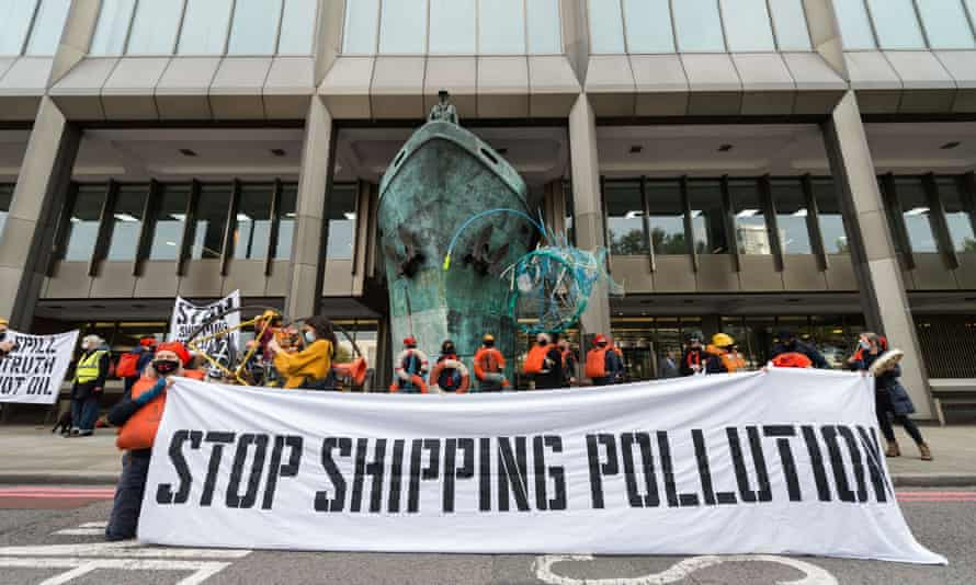 Activists from Ocean Rebellion hold a banner reading 'Stop shipping pollution' outside the UN's International Maritime Organization headquarters in London in October 2020.
