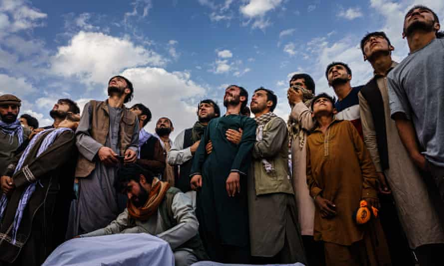 Family members attending a mass funeral for the 10 they say were killed in a US drone strike.