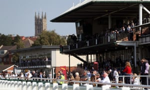 Racegoers await the start of the opening race at Warwick on Monday.