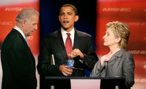Senator Joe Biden talks with senators Barack Obama and Hillary Rodham Clinton before the Democratic presidential primary debate on 26 April 2007.