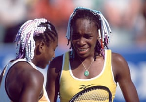 Sisters Venus (right) and Serena Williams during a doubles match in 1999.