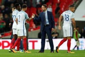 Southgate, Welbeck and Walker celebrate after the final whistle.