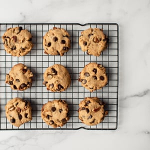 Overhead view of freshly baked chocolate chip cookies on cooling rack.