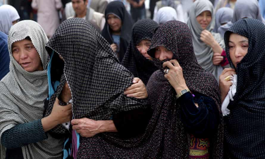 Afghan women mourn during the funeral of victims of the Kabul bombing.