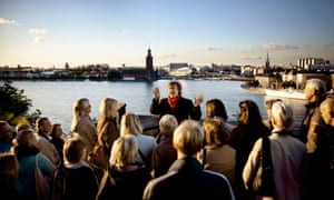 Guests on the Millennium tour in Stockholm, Sweden. The tour takes in city locations relevant to author Stieg Larsson's Millennium trilogy, including The Girl with the Dragon Tattoo.