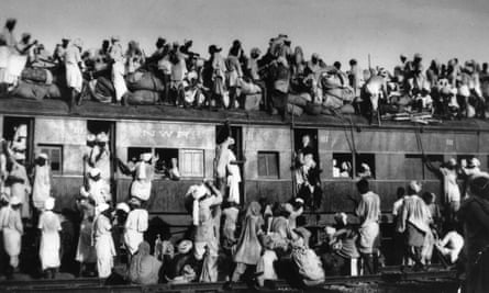 Muslim refugees attempting to flee India sit on the roof of an overcrowded train near Delhi in September 1947