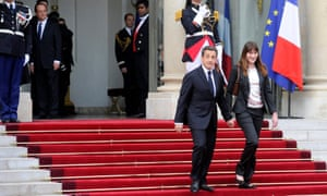 Nicolas Sarkozy and Carla Bruni leaving the Elysée palace in May 2012, as François Hollande looks on.