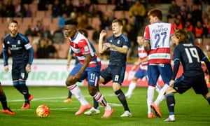 Granada striker Isaac Success robs Toni Kroos of the ball.