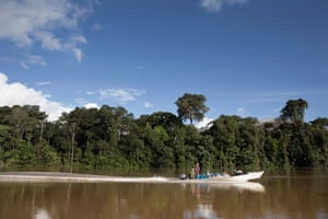 Members of the Funai expedition team head down the Rio Ituí, inside the Javari Valley reserve